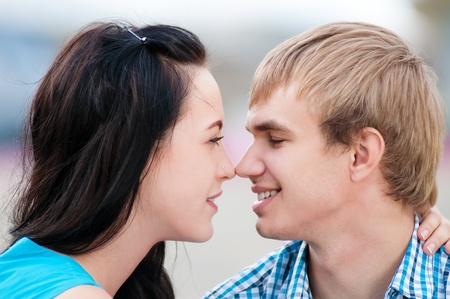 Portrait of a beautiful young happy smiling couple - green park outdoor Stock Photo - 15262782