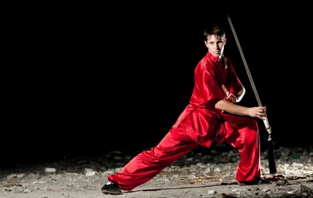 Shaolin warrs wushoo man in red practice martial art outdoor. Kung fu Stock Photo - 15290941