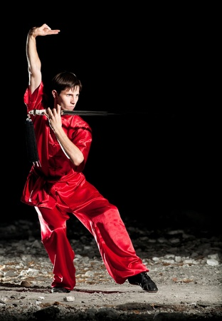 Shaolin warriors wushoo man in red practice martial art outdoor. Kung fu Stock Photo - 15262574