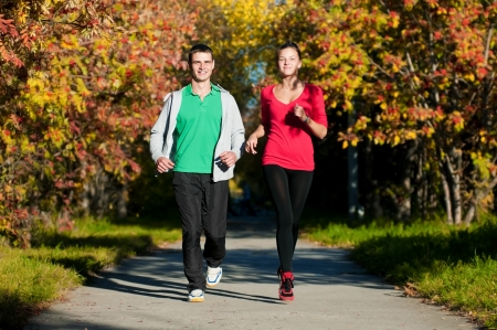 Young fitness couple of man and woman jogging in park Stock Photo - 15262754