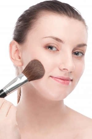 Close-up portrait of young beautiful woman with brush for make-up. Cheek zone Stock Photo - 15262758