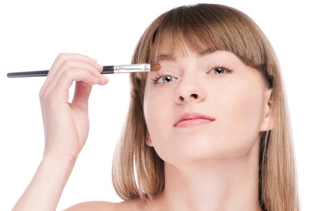 Close-up portrait of young beautiful woman with brush for make-up. Eye shadow zone Stock Photo - 15262764