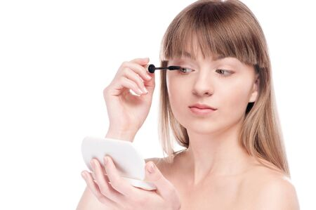 Close-up portrait of young beautiful woman with brush for make-up. Mascara, eye zone Stock Photo - 15262726