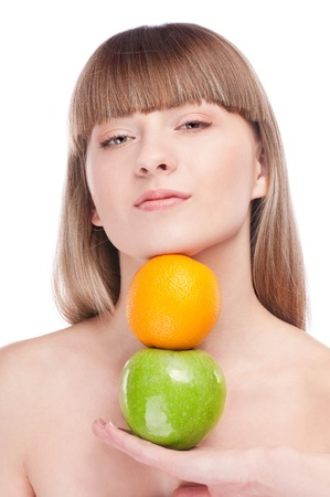 Young beauty woman with green apple and orange. Isolated on white  Stock Photo - 15262766