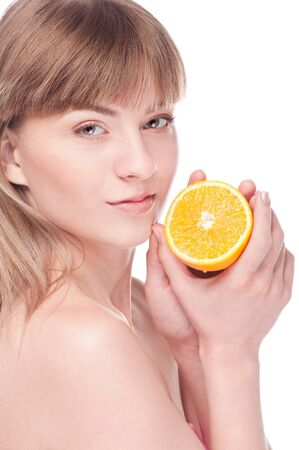 Young beauty woman with orange. Isolated on white Stock Photo - 15262778