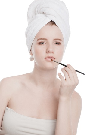 Close-up portrait of young beautiful woman with brush for make-up. Lips zone Stock Photo - 15262734
