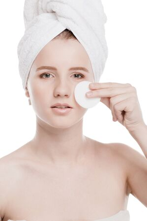 Close-up portrait of young woman with perfect health skin of face, bath towel on head and clean sponge. Isolated on white Stock Photo - 15262743