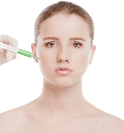 Cosmetic botox injection in the female face. Nose zone. Isolated on white Stock Photo