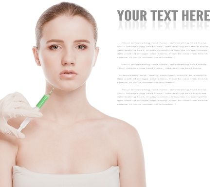 Cosmetic botox injection in the female face. Lips zone. Isolated on white Stock Photo - 15262736