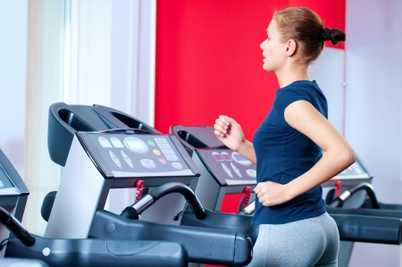 Young woman at the gym exerce. Jog on machine Stock Photo - 15619938
