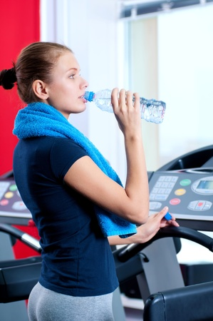 Portrait of a woman at the gym drinking water  Stock Photo - 15620061