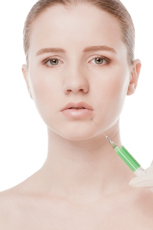 Cosmetic botox injection in the female face. Lips zone. Isolated on white Stock Photo - 15620055