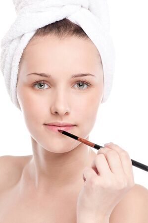 Close-up portrait of young beautiful woman with brush for make-up. Lips zone Stock Photo - 15620042