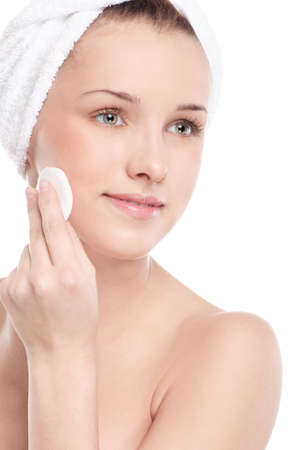 Close-up portrait of young woman with perfect health skin of face, bath towel on head and clean sponge. Isolated on white Stock Photo - 15620036