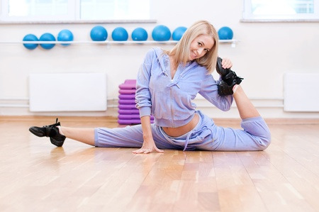 Smiling woman do stretching exercise in sports club. Fitness gym Stock Photo - 15635181