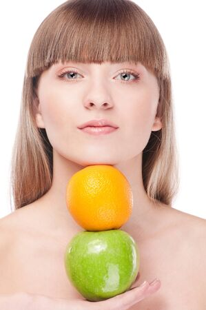 Young beauty woman with green apple and orange. Isolated on white  photo