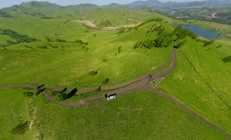 Beautiful small green mountain road from above  aerial view  photo