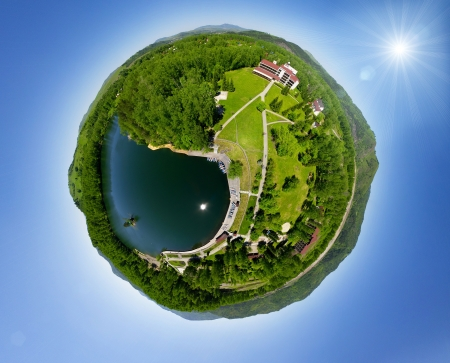 Beautiful small green village from above  aerial view  little planet concept Standard-Bild