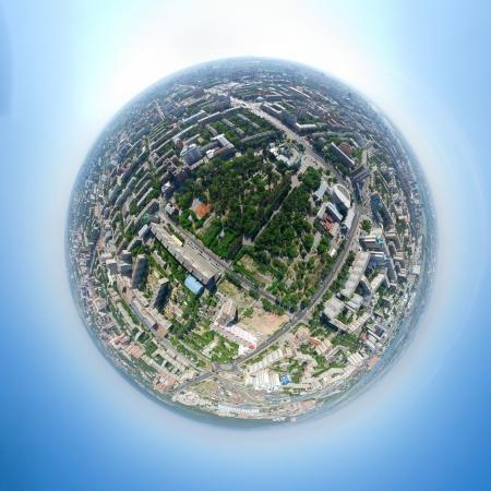 Aerial city view with crossroads, roads, houses, parks, parking lots, bridges