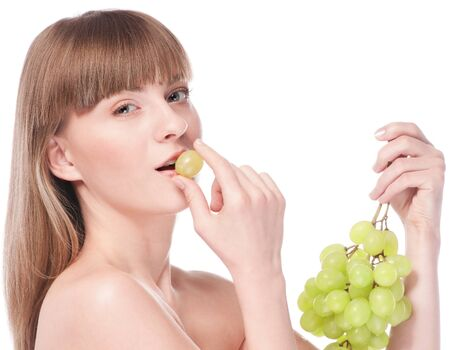 Beautiful young woman with green grape. Isolated on white Stock Photo - 16474962