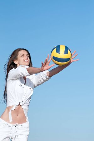 Young beautiful woman playing volleyball on beach Stock Photo - 16405150