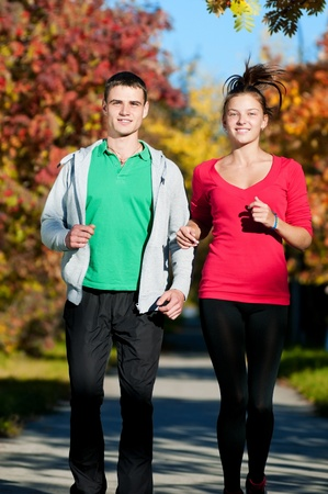 Young fitness couple of man and woman run in park  Stock Photo - 16405165
