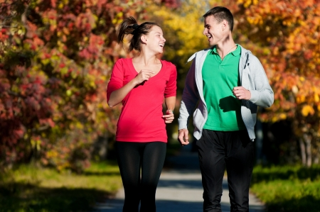 Young fitness couple of man and woman jogging in park  Stock Photo - 16405174