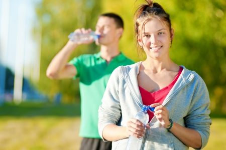Man and woman drinking water from bottle after fitness sport exercise Stock Photo - 16405160