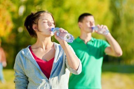 Man and woman drinking water from bottle after fitness sport exercise Stock Photo - 16405170