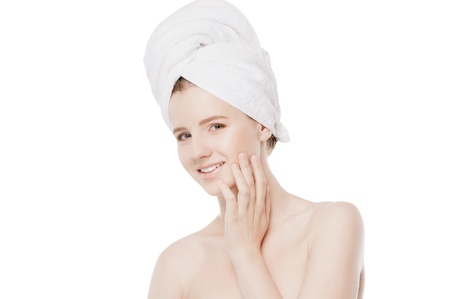 Close-up portrait of young woman with perfect health skin of face and bath towel on head. Isolated on white Stock Photo - 16405184