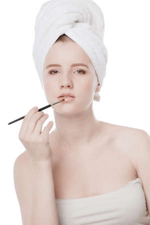 Close-up portrait of young beautiful woman with brush for make-up. Lips zone Stock Photo - 16405166