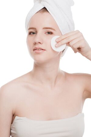 Close-up portrait of young woman with perfect health skin of face, bath towel on head and clean sponge. Isolated on white Stock Photo - 16405171
