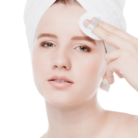 Close-up portrait of young woman with perfect health skin of face, bath towel on head and clean sponge. Isolated on white Stock Photo - 16405193