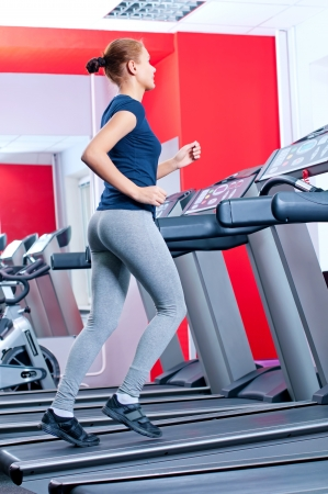 Young woman at the gym exercising. Run on machine Stock Photo - 16405157