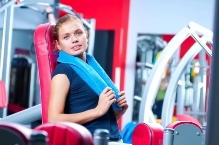 Woman at the gym exercising on a machine Stock Photo - 16405154