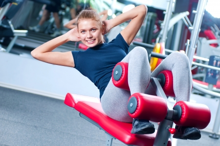 Woman at the gym exercising on a machine Stock Photo - 16405146