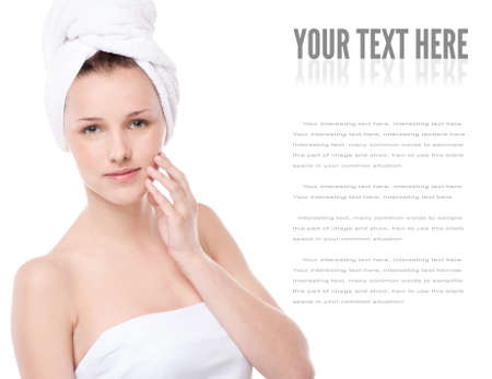 Close-up portrait of young woman with perfect health skin of face and bath towel on head. Isolated on white Stock Photo - 16405140