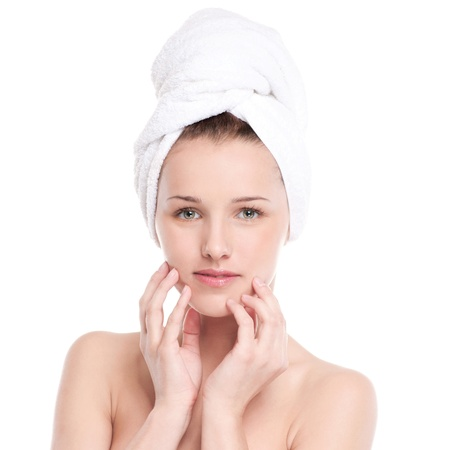 Close-up portrait of young woman with perfect health skin of face and bath towel on head. Isolated on white Stock Photo - 16405172