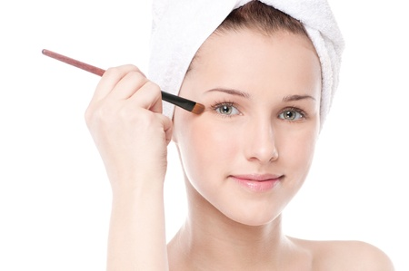 Close-up portrait of young beautiful woman with brush for make-up. Eye zone Stock Photo - 16405155
