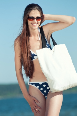 Beautiful Summer Woman on the Beach with white bag Stock Photo - 16763711