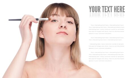 Close-up portrait of young beautiful woman with brush for make-up. Eye shadow zone Stock Photo - 16763754