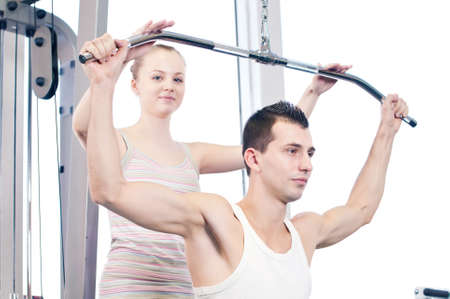 Gym man and woman doing exercise at the fitness club. Personal trainer. Stock Photo - 16763746