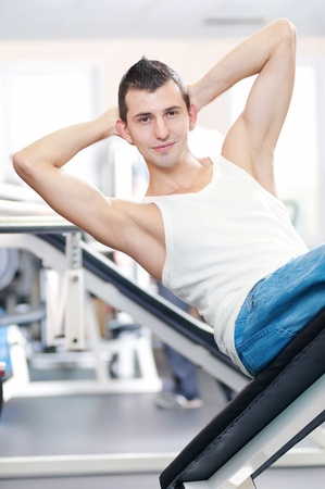 Young man doing exercises with sport equipment at gym club Stock Photo - 16763713