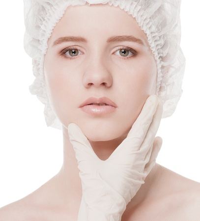 Medical examination face of beautiful woman by hands in glove - close-up portrait isolated on white Stock Photo - 16763747
