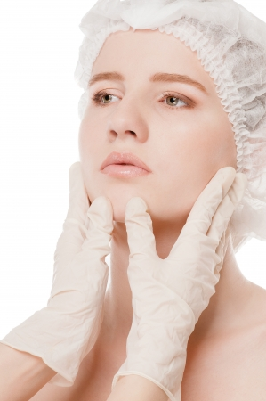 Medical examination face of beautiful woman by hands in glove - close-up portrait isolated on white  Stock Photo - 16763765