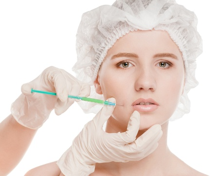 Cosmetic botox injection in the female face. Lips and cheek zone. Isolated on white Stock Photo - 16763750
