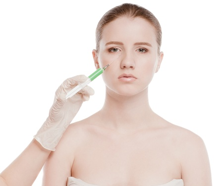 Cosmetic botox injection in the female face. Eye and eyebrow zone. Isolated on white Stock Photo - 16763727