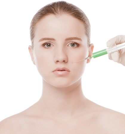 Cosmetic botox injection in the female face. Nose zone. Isolated on white Stock Photo - 16763732