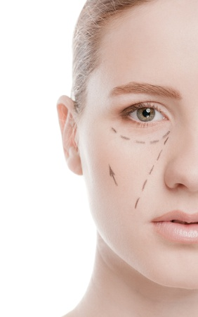 Beautician draw correction lines on woman face. Before plastic surgery operetion. Isolated on white Stock Photo - 16763760