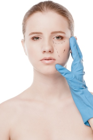 Beautician touch and draw correction lines on woman face. Before plastic surgery operetion. Isolated on white Stock Photo - 16763767